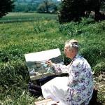 Grandma Moses Painting On The Hillside
