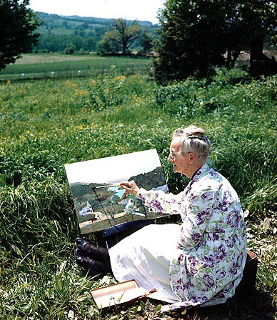 Grandma Moses Painting On The Hillside